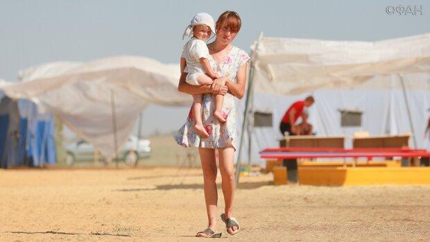 Решение Кабмина разъярило матерей-одиночек: урезать выплаты на 50%